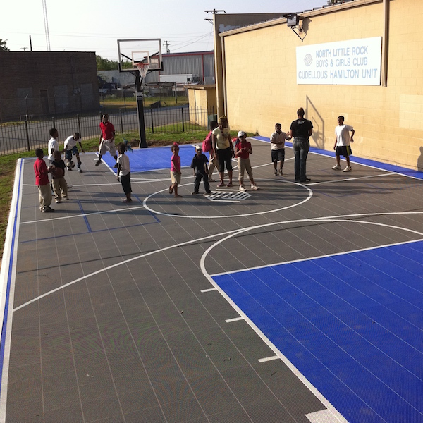 Kids playing on a Sport Court basketball court